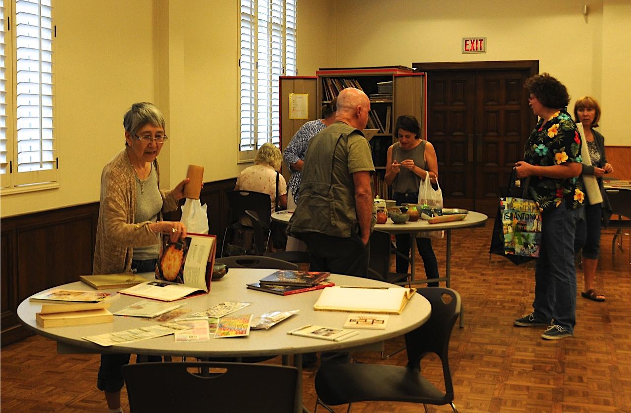 Members Looking at exhibit tables